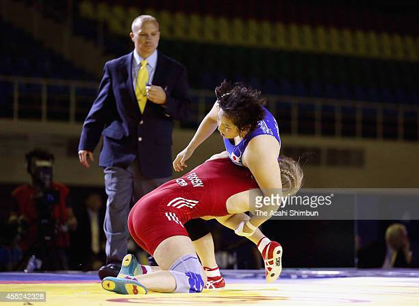 Aline Focken of Germany and Sara Dosho compete in the Women's 69kg final match during day three of the FILA World Wrestling Championships at...