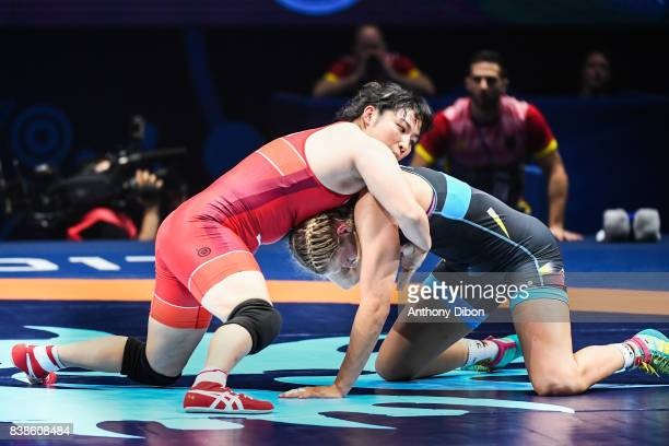 Aline Focken of Germany and Sara Dosho of Japan celebrates the victory during the female wrestling competition during the Paris 2017 Women's World...