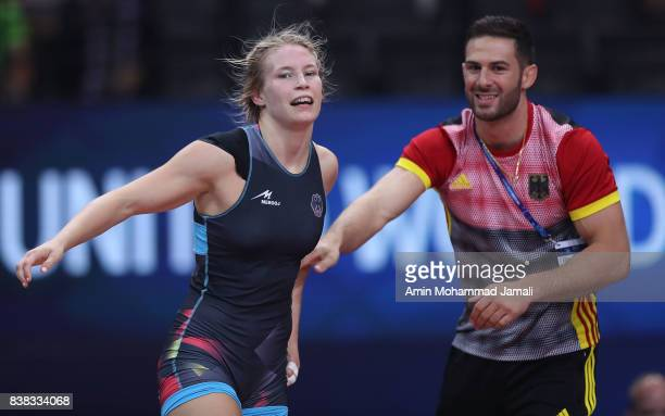 Aline Focken of Germany celebrates after her victory against Yue Han of China during World Wrestling Championships in semifinal Women's wrestling...