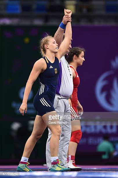 Aline Focken of Germany celebrates victory over Martina Kuenz of Austria in the Women's Freestyle 69kg Wrestling Bronze Final during day three of the...