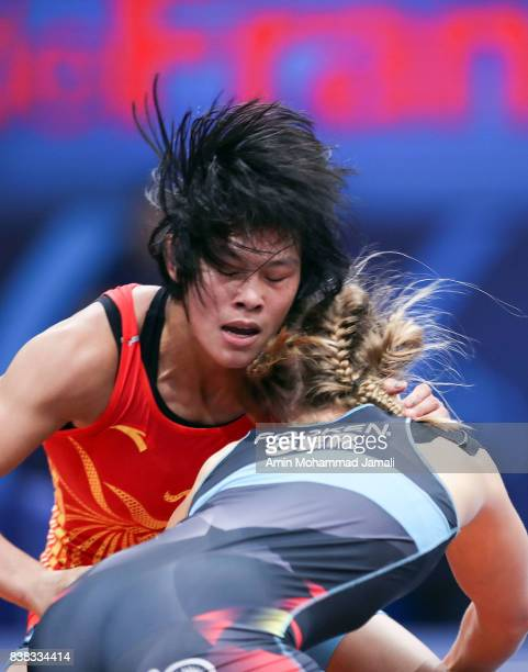 Aline Focken of Germany in action against Yue Han of China during World Wrestling Championships in semifinal Women's wrestling Seniors 69kg at...