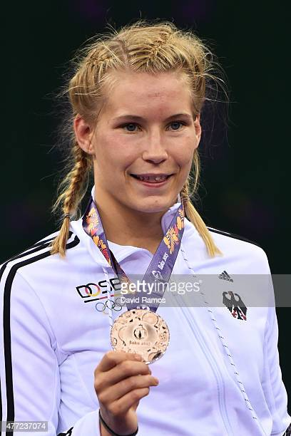 Aline Focken of Germany poses with her bronze medal won in the Women's Freestyle 69kg Wrestling Bronze Final during day three of the Baku 2015...