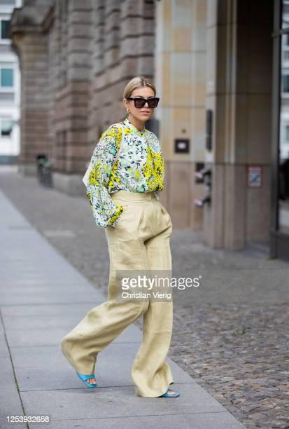 Aline Kaplan is seen wearing blouse Lala Berlin Massimo Dutti wide leg pants Demellier London bag Zara shoes Celine sunglasses on July 02 2020 in...