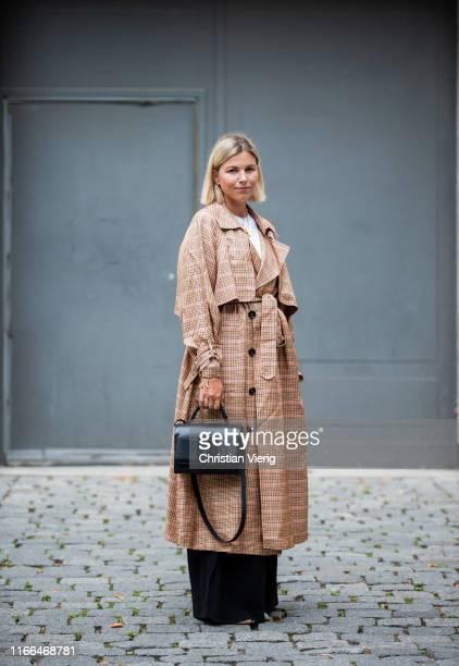 Aline Kaplan is seen wearing trench coat Golden Goose, Tibi shoes, wide leg Mango pants, Boyy bag on August 05, 2019 in Berlin, Germany.