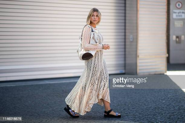 Aline Kaplan wearing By Malene Birger dress Nanushka bag shoes Prada is seen on April 25 2019 in Berlin Germany