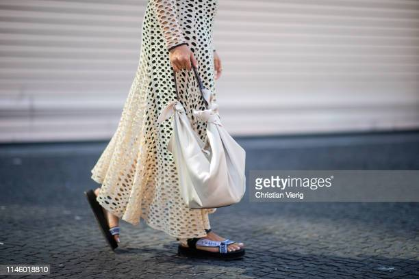 Aline Kaplan wearing By Malene Birger dress, Nanushka bag, shoes Prada is seen on April 25, 2019 in Berlin, Germany.