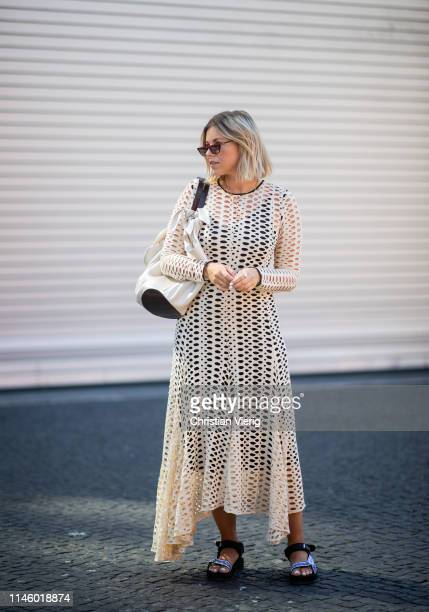 Aline Kaplan wearing By Malene Birger dress Nanushka bag sunglasses and shoes Prada is seen on April 25 2019 in Berlin Germany