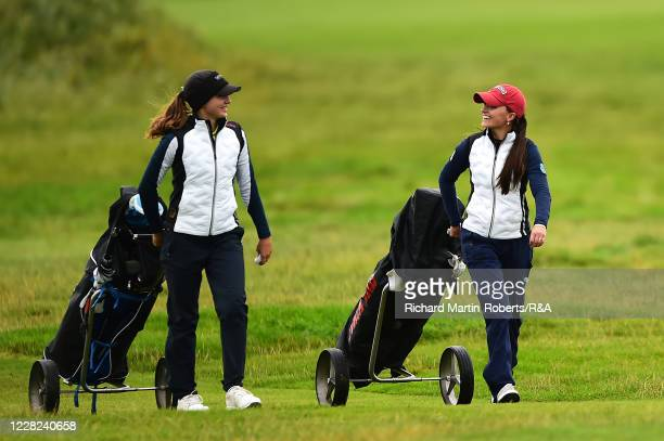Aline Krauter of Germany chats with Paula SchulzHanssen of Germany during the Quarter Finals on Day Four of The Women's Amateur Championship at The...