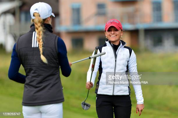 Aline Krauter of Germany is congratulated by Annabell Fuller of England on the 18th green after her victory during the Final on Day Five of The...