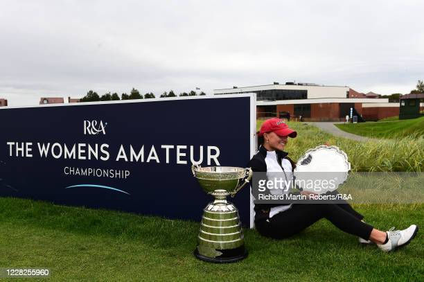 Aline Krauter of Germany looks at the trophy following her victory during the Final on Day Five of The Women's Amateur Championship at The West...