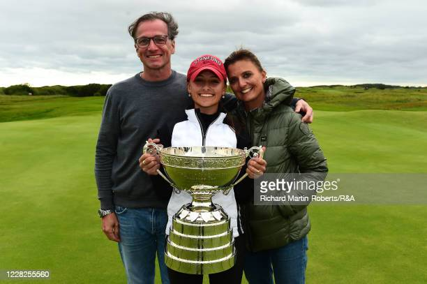 Aline Krauter of Germany poses with the trophy and her parents Karina and Rolf following her victory during the Final on Day Five of The Women's...