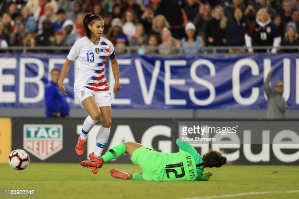 Aline Reis of Brazil blocks a ball from Alex Morgan of USA in the first half during the She Believes Cup at Raymond James Stadium on March 05 2019 in...