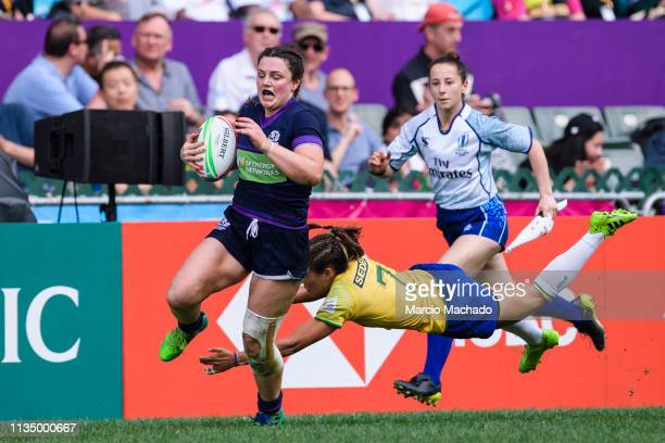 Aline Ribeiro Furtado tries to put a tackle on Abi Evans of Scotland on day one of the Cathay Pacific/HSBC Hong Kong Sevens Women's Final match...