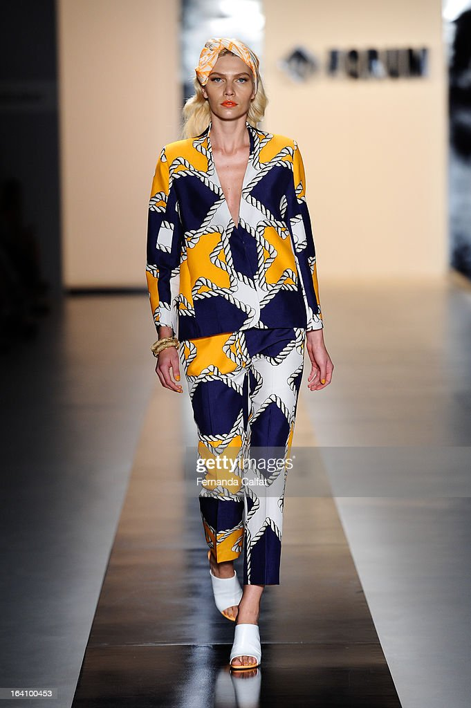 Aline Weber walks the runway during the Forum show during Sao Paulo Fashion Week Summer 2013/2014 on March 19, 2013 in Sao Paulo, Brazil.