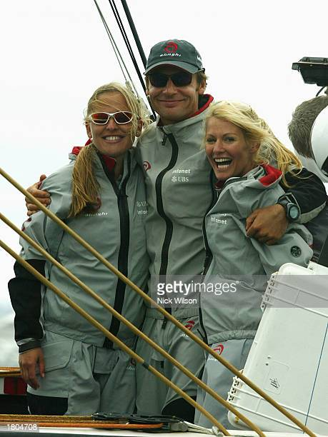 Alinghi Syndicate head Ernesto Bertarelli with wife Kirsty and her sister Donna relax on board Alinghi as racing was called off due to shifty...
