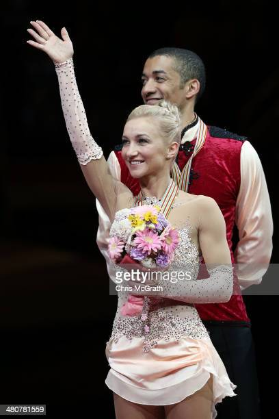 Aliona Savchenko and Robin Szolkowy of Germany celebrate first place during the victory ceremony for the Pairs Free Program during ISU World Figure...