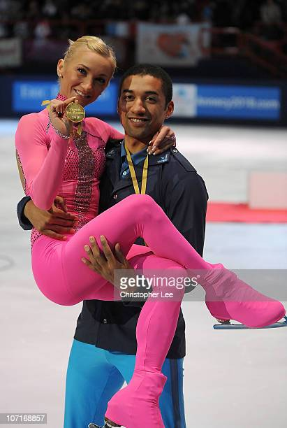Aliona Savchenko and Robin Szolkowy of Germany celebrate winning Gold in the Pairs Program during the ISU GP Trophee Eric Bompard 2010 at the Palais...