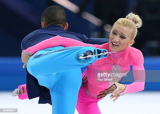 Aliona Savchenko and Robin Szolkowy of Germany compete during the Figure Skating Pairs Short Program on day four of the Sochi 2014 Winter Olympics at...