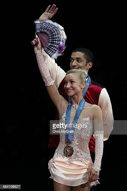 Aliona Savchenko and Robin Szolkowy of Germany wave to the crowd during the Pairs Free Skating Final victory ceremony on day three of the ISU Grand...