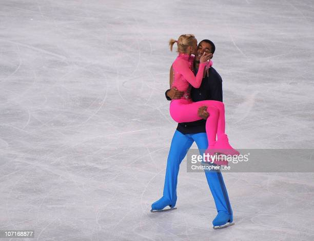 Aliona Savchenko kisses Robin Szolkowy of Germany as they celebrate their performance in the Pairs Free Skating during the ISU GP Trophee Eric...