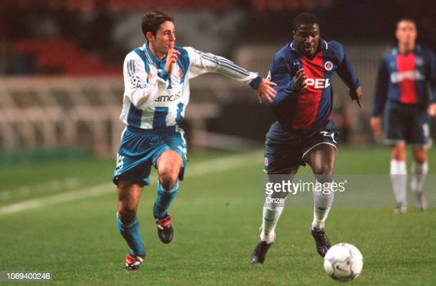 Aliou CISSE and Sanchez Del Amo VICTOR during the champion's league match between Paris Saint Germain and Deportivo La Corgne on November 21 2000 in...