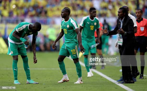 Aliou Cisse Head coach of Senegal gives instructions to Cheikhou Kouyate and Sadio Mane of Senegal during the 2018 FIFA World Cup Russia group H...