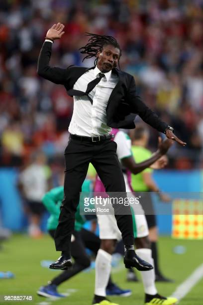 Aliou Cisse Head coach of Senegal jumps in the air as he celebrates his sides second goal during the 2018 FIFA World Cup Russia group H match between...