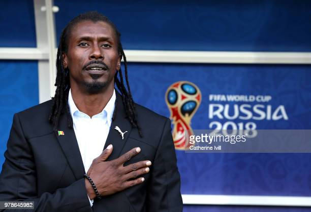 Aliou Cisse Head coach of Senegal sings national anthem prior to the 2018 FIFA World Cup Russia group H match between Poland and Senegal at Spartak...