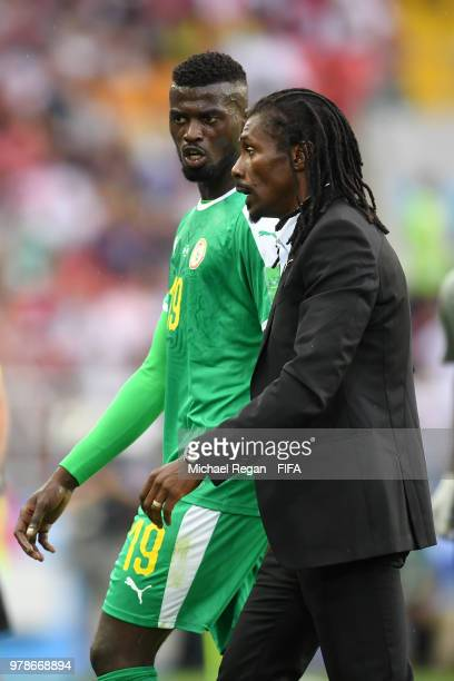 Aliou Cisse Head coach of Senegal talks to Mbaye Niang of Senegal at half time during the 2018 FIFA World Cup Russia group H match between Poland and...