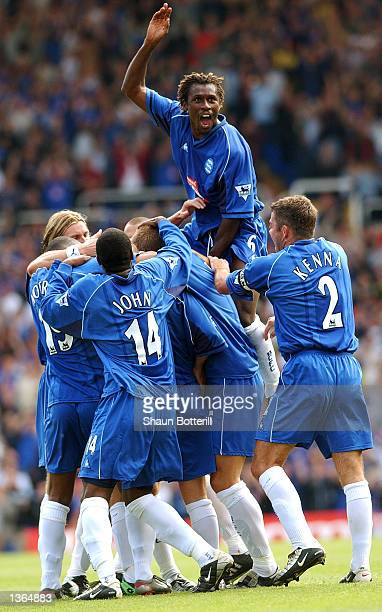 Aliou Cisse leads the Birmingham City celebration after his team mate Paul Devlin's goal during the FA Barclaycard Premiership match between...