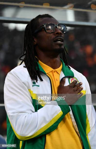 Aliou Cisse Manager of Senegal sings the national anthem during the International Friendly match between the Ivory Coast and Senegal at the Stade...