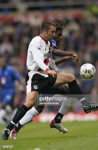 Aliou Cisse of Birmingham City and Kevin Horlock of Manchester City go for the ball during the FA Barclaycard Premiership match between Birmingham...