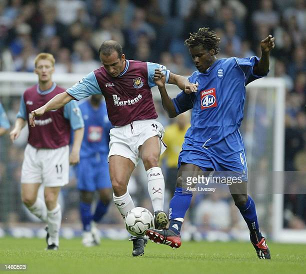 Aliou Cisse of Birmingham City tries to tackle Paolo Di Canio of West Ham United during the FA Barclaycard Premiership match between West Ham United...