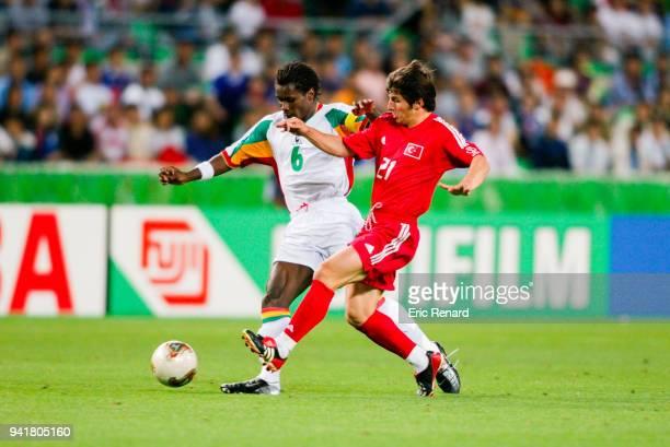 Aliou Cisse of Senegal and Emre Belozoglu of Turkey during the World Cup quarter final match between Senegal and Turkey in Nagai Stadium in Osaka...