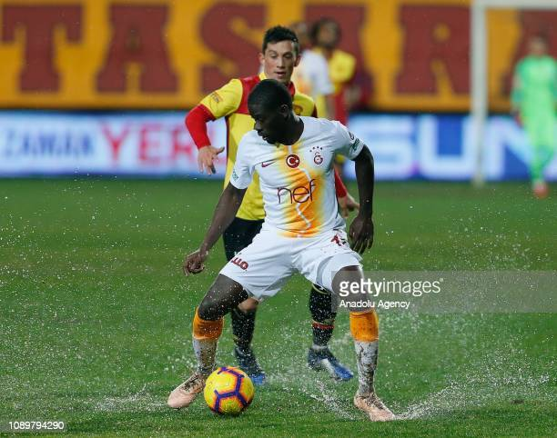 Alioune Ndiaye of Galatasaray in action against Andre Castro of Goztepe during a Turkish Super Lig soccer match between Goztepe and Galatasaray at...