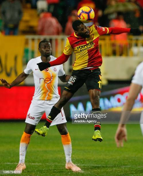 Alioune Ndiaye of Galatasaray in action against Andre Poko of Goztepe during a Turkish Super Lig soccer match between Goztepe and Galatasaray at...