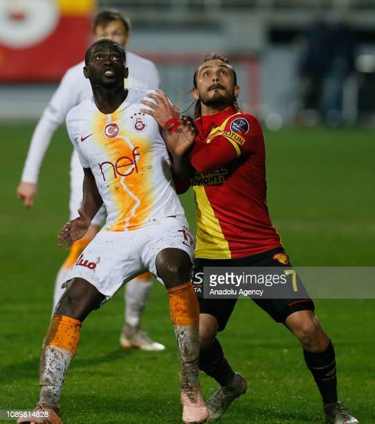 Alioune Ndiaye of Galatasaray in action against Halil Akbunar of Goztepe during a Turkish Super Lig soccer match between Goztepe and Galatasaray at...