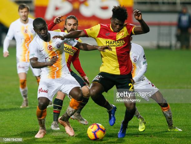 Alioune Ndiaye of Galatasaray in action against Lamine Gassama of Goztepe during a Turkish Super Lig soccer match between Goztepe and Galatasaray at...