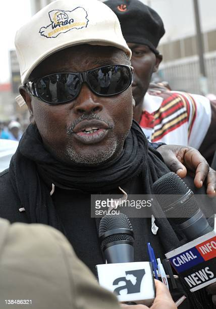 Alioune Tine coordinator of the M23 opposition movement speaks to journalists on February 7 2012 during a march through central Dakar to ratchet up...