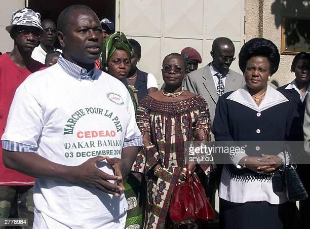 Alioune Tine executive secretary of Rencontres Africanes des Droits de l'Homme delivers a speech as Fatimata Toure Tanoe Ivory Coast ambassador to...