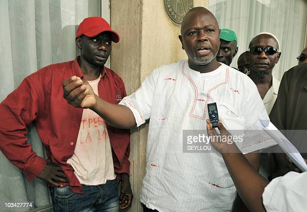 Alioune Tine member of African NGO for the Defense of Human Rights speaks to the media next to Senegalese artist Souleymane Diouf aka Farah on August...
