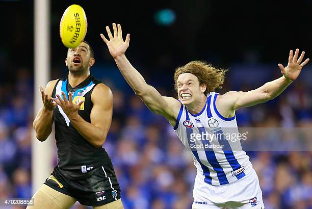 Alipate Carlile of the Power and Ben Brown of the Kangaroos compete for the ball during the round three AFL match between the North Melbourne...