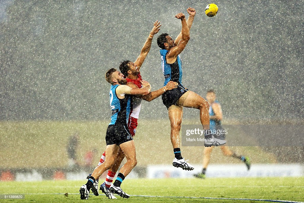 Alipate Carlile of the Power punches the ball during the 2016 NAB Challenge AFL match between the Sydney Swans and Port Adelaide Power at Blacktown International Sportspark on February 20, 2016 in Sydney, Australia.