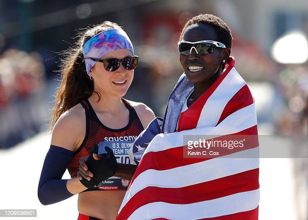 Aliphine Tiliamuk reacts with Molly Seidel after they finished first and second in the Women's US Olympic marathon team trials on February 29 2020 in...