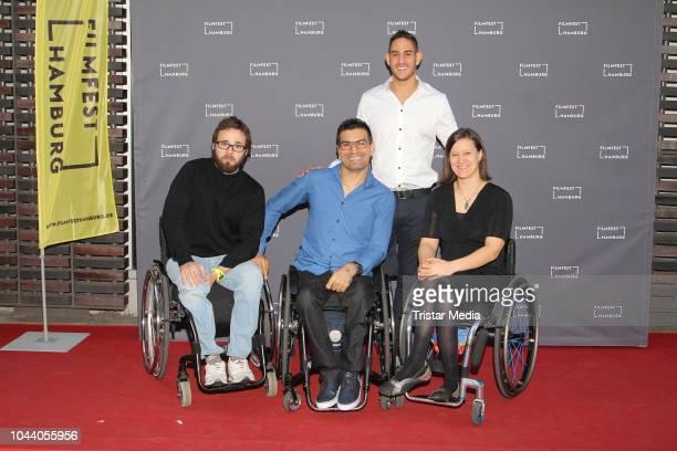 Alireza Ahmadi Asael Shabo and Anne Patzwald attend the 'Vierzehneinhalb Kollisionern' premiere during the Film Festival on September 30 2018 in...