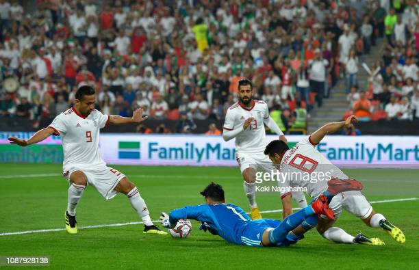 Alireza Beiranvand of Iran jumps onto the loose ball during the AFC Asian Cup quarter final match between China and Iran at Mohammed Bin Zayed...