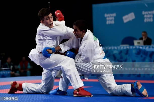 Alireza Farajikouhikheili of Iran and Pedropablo del Roca Lopez of Guatemala compete Men's Kumite 61kg Elimination Round Pool B during day 11 of...