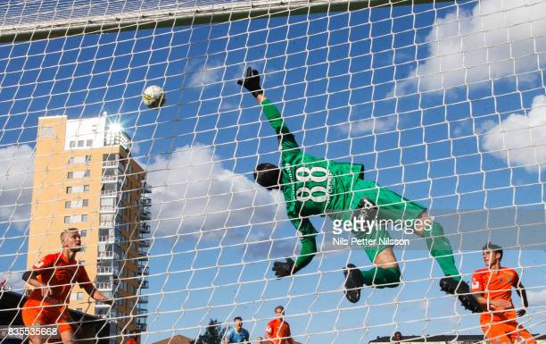 Alireza Haghighi goalkeeper of Athletic FC Eskilstuna makes a save during the Allsvenskan match between Athletic FC Eskilstuna and Malmo FF at...