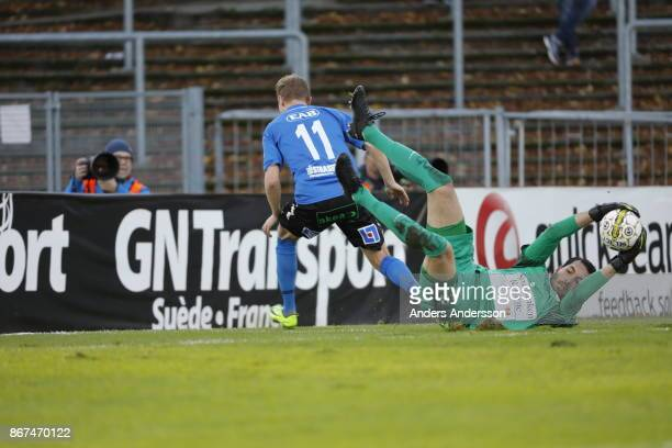 Alireza Haghighi goalkeeper of Athletic FC Eskilstuna makes a save during the Allsvenskan match between Halmstad BK and Athletic FC Eskilstuna at...