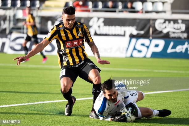 Alireza Haghighi goalkeeper of Athletic FC Eskilstuna tackles by Ahmad Yasin of BK Hacken during the Allsvenskan match between BK Hacken and Athletic...